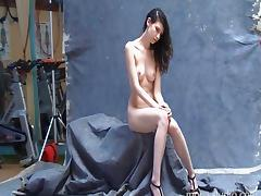 Naughty brunette poses backstage in nothing but high heels