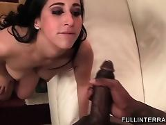 Brunette barely fitting black dick in her mouth