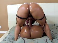 Bubble butt ebony sluts having fun with a big long strap-on