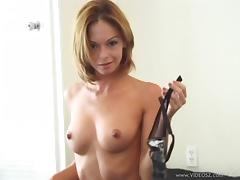 Beautiful cougar with big tits playing with her shaved pussy