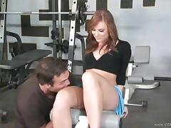 Redhead Dani Jensen in miniskirt is being banged Hardcore in the gym