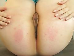Little Brunette with glasses masturbating on the table