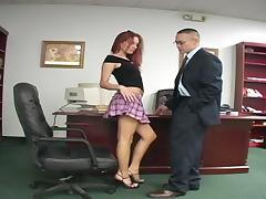 Mini-skirt clad redhead with gorgoues natural boobs playing with a stranger's cock