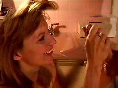 Bathroom facial for blonde MILF