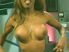 Smutty ebony babe flaunts her fake tits in enchanting backstage compilation tube porn video