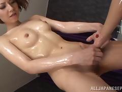 Stunning oiled-up Asian babe with a slim body sucking a stranger's cock
