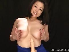Salacious Asian cougar with huge tits playing with a stranger's cock