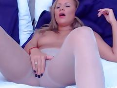 Blonde cam girl with vibrator in her pantyhose
