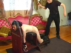 Small tits hottie spanked with a paddle