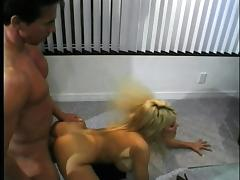 Brooke Lane takes a Peter North load in the face