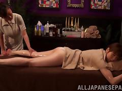 Lewd Japanese lesbian enjoys an oily massage with a happy ending tube porn video