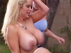 Blonde with huge tits has her pussy eaten in front lawn by lesbian friends