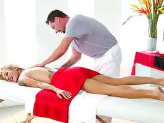 Tattooed blonde shows her masseuse her gratitude for a hot massage