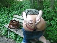 Slut having anal dildo fun outside