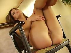Naked babe on a wooden chair flashes her cock hungry cunt