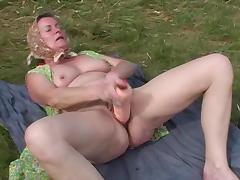 Masturbating granny in the grass blows the camera guy