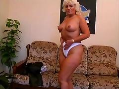 A curvy, mature amateur pounds her pussy with a dildo