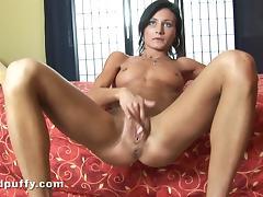 Brunette with small tits masturbates,rubbing shaved pussy in solo scene