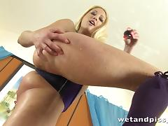 Slutty blonde with a nice ass pissing in a glass after masturbating