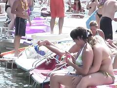 Bikini clad pornstar shows off her sexy ass at a wild bikini party at the lake