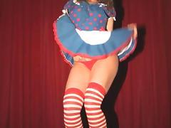 Mini-skirt clad stripper with long dark hair touching her hot ass