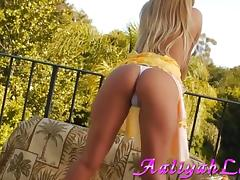 While relaxing outside Aaliyah Love rubs her tight, bald pussy