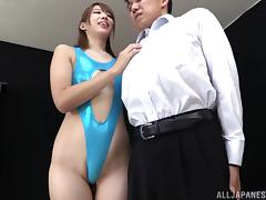 Gorgeous Japanese cowgirl in a sexy swimsuit delivers a foot job after being spooked