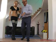Lingerie clad cowgirl gives her stud a blowjob after being slammed on the sofa