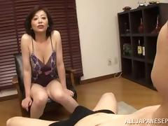 Sexy mature Asian woman uses het saggy tits to please a guy