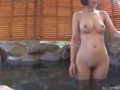 Big Japanese tits wrap around his dick in the hot tub