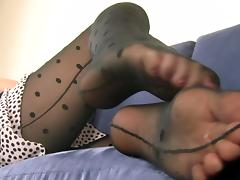 Teasing woman rubbing her cute feet together while wearing pantyhose tube porn video