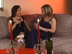 Lingerie wearing babes share some wine then eat some pussy