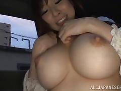 Japanese pornstar with big tits fondles her big tits then fingers her cunt in the van solo
