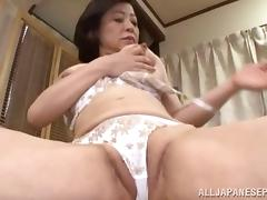 Lingerie-clad Asian cougar with big tits playing with her pussy