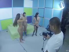 Erotic backstage shoot with sexy vixens taking turns milking a pecker
