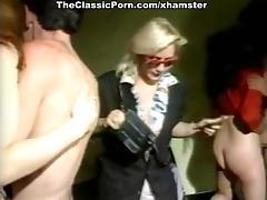 Kelly Nichols, Tigr, Justin Simon in vintage xxx scene