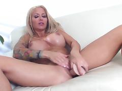 Hot MILF Helly Hellfire fucks around with a toy