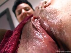 Thong-clad cougar with short dark hair sucking her boyfriend's cock