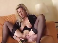 Saggy blonde mature fucks herself with a cucumber