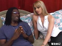 Beautiful blonde whore with great juggs sucking a big black cock