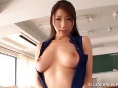 Stunning Japanese MILF loves her big tits being played with