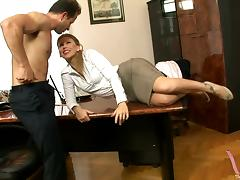 A guy puts his secretary on the desk and bangs her brains out