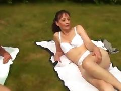Brunette sex doll getting her pussy fisted then plowed in an outdoors groupsex tube porn video