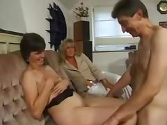 Lewd milf shares her hubby with her best friend on the couch