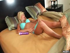 Alone in bed a blonde MILF slams her toy inside her pussy