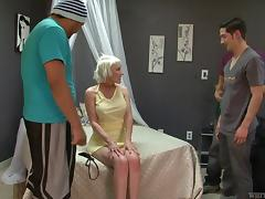 Mature blonde with implants takes three cocks in a gangbang
