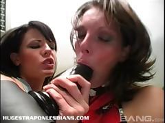 Sapphic sluts enjoy using massive toys on their aching cunnies