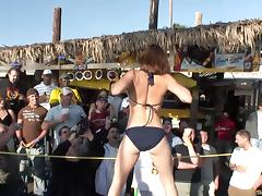 Sexy pornstar goes topless at a kinky bikini party