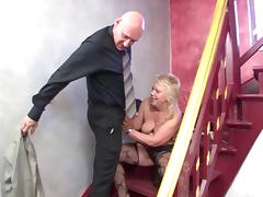 Mature woman sucks her neighbor's cock in the stair case