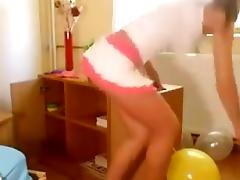Hot Russian girl in Miniskirt Sit Pops Balloons